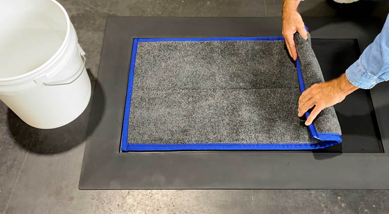SaniStride easy clean-up of shoe sanitizer and boot disinfectant mat