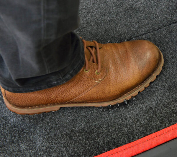 Sanistride shoe disinfectant mat insert dispenses customer's disinfectant to bottom of shoes thoroughly saturating treads